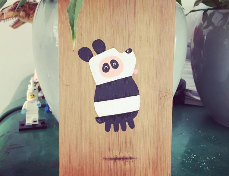 Hofbogen ondernemer: Ckoe, illustratie, Uier in pandapak op bamboo